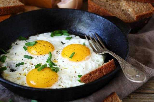 Hot fried eggs in a pan